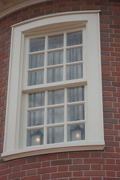 """If you look closely at the second-story windows near the """"Hall of Presidents,"""" you'll see two lanterns. They are referencing the line """"One i..."""