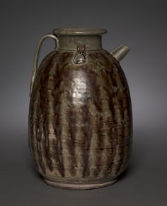 China, Hunan province, Tang dynasty (618-907), stoneware with olive-green glaze and ironbrown splashes, Changsha ware, Overall: 29.2 x 19.8 cm (11 7/16 x 7 3/4 in.); Diameter of rim: w. 10.3 cm (4 in.). Edward L. Whittemore Fund 2005.57