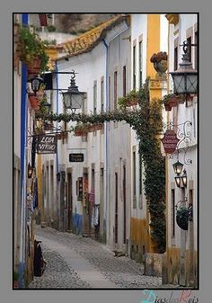 Main street, Óbidos, Portugal. i loved this village...the people...the tile shops...the architecture