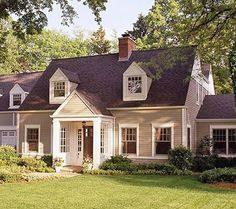 This cozy Cape Cod best illustrates the exterior color scheme of my dream home -- warm taupe and crisp white.