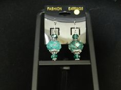 Check out this item in my Etsy shop https://www.etsy.com/listing/267168994/aqua-green-crystal-disco-earrings