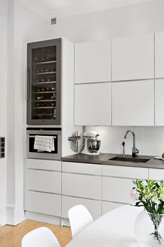 Speaking of wine, these built-in cabinets have a wine chiller as a part of their setup. For the life of me, I can't figure out why the door handle is wall-side, but that's the only fault I can find amongst these clean lines. #ThisOldHouse inspiration via www.L-2-Design.com