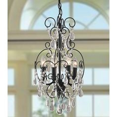 This chic, compact 4-light chandelier features an elegant metal black frame with intricate crystal embellishments that are a perfect fit for any room. This fixture accepts four 60-watt candelabra bulbs and provides ample overhead lighting.