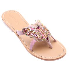 If you are lacking a bit of whimsy in your life, look no further than these hand- beaded butterfly thongs. The pink jeweled details make this the perfect, feminine statement pair of sandals. Hand-Made