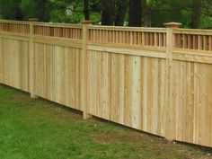 A natural wood cedar privacy fence, featuring tongue and groove privacy fence panels with an Essex hopper, supported by square columns with square top caps - Malone Fence Company Salem MA