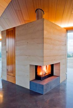 Rammed earth, timber and polished concrete. This is the work of Sydney based Architect, James Stockwell. If colder weather is setting in in your part of the world, you'll find more fireplace inspiration on our site at http://theownerbuildernetwork.co/ideas-for-your-rooms/living-rooms-gallery/humankind-and-fire/ Nice setting?