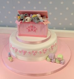 Ava's toy box themed christening cake, featuring some of her favourite toys. www.vintagehousebakery.co.uk