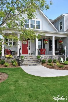 Love love love craftsman homes with a front red door....gotta have it! :)