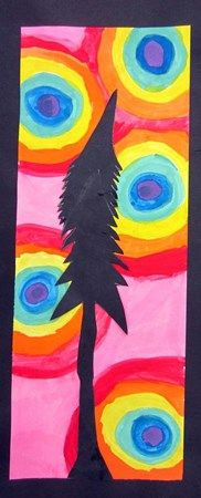 """Students learned color wheel order while painting their backgrounds. Each student began with 5 painted dots in the color of their choice, then created bands around that color in color wheel order. I asked each student to interpret the theme of a """"tree"""" to create the silhouette in black paper."""