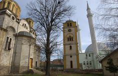 Ferizaj, Kosovo. A mosque and a church share the same place/yard.
