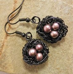 pale brown freshwater pearl eggs in black nest earrings
