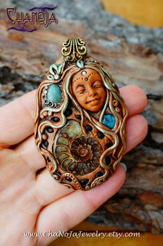 Ammonite Goddess Pendant-crystal jewelry fossil neon blue apatite raw mineral garnets aquamarine faerie woodland magical feminine by chanoja. The Ammonitte Goddess is indeed a breathtaking statement piece and eyecatcher - WOW. I am so i love with her.  Creating art is my life - it is one of my callings. Please feel every essence of me being poured uncontrollably into this striking one of a kind handcrafted piece.