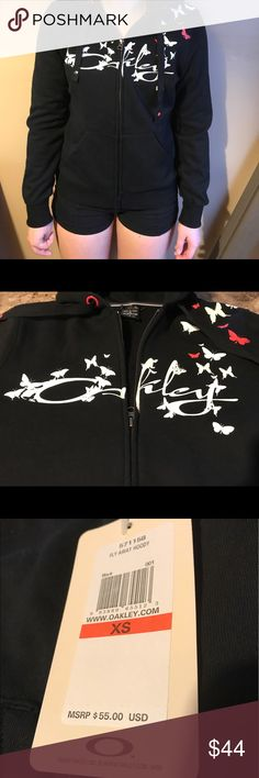 NWT! OAKLEY Fly Away Hoody Black White Red XS New with tags! Misses Oakley Fly Away Hoody. Black with Oakley and butterflies in white, also red butterflies and accents. Size XS - smoke free and pet free home. Oakley Tops Sweatshirts & Hoodies