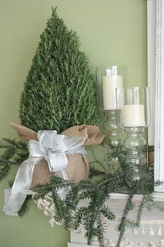 Use a Real Rosemary Bush on the Mantel. Wrap base in burlap and adorn with silver bow.
