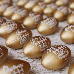 An elegant spin on an American classic. 🏈 These mini footballs painted gold make perfect escort cards for any football-obsessed couple. Wedding Favor Table, Edible Wedding Favors, Wedding Koozies, Wedding Invitations, Anniversary Invitations, Wedding Signage, Wedding Seating, Wedding Stationery, Wedding Anniversary