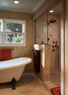 nice pony wall separating clawfoot tub and shower