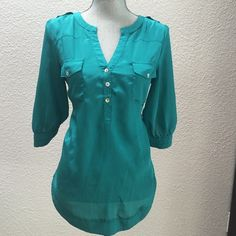 41 Hawthorn teal blouse 41 Hawthorn real blouse from Stitch Fix. One small pinpoint hole from tag (see last photo). Tapered at waist, with beautiful hem detail and even more lovely sleeves (see back photo). 41 Hawthorn Tops Blouses