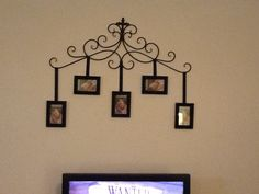 My creation...I seen some of the Pinterest projects that you can use a curtain to hang pictures...I found this piece at Hobby Lobby & I had black ribbon and bought the frames...got to add my pics of course but I was so proud how it turned out.  :)  Feel free to repin ;)