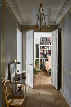 Fashion Designer Alexis Mabille's Paris Apartment Is a Romantic's Dream - Fashion Designer Alexis Mabille's Paris Apartment Is a Romantic's Dream an entry hallways with a table at left with next to a chair and open doors at the end exposing a bedroom Architectural Digest, Bedroom Lamps Design, Bedroom Chandeliers, Bedroom Ideas, Bedroom Lighting, Bedroom Inspiration, French Apartment, Dream Apartment, Paris Apartment Decor