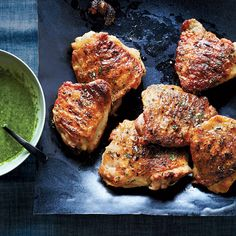 These outstanding chicken thighs have two great sauces: a vibrant parsley-garlic sauce and honey-horseradish butter that's brushed on the chicken as it grills.