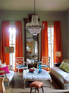Love this room! High ceilings with those wonderful orange taffeta curtains, the huge tufted bench, and on and on....love it!