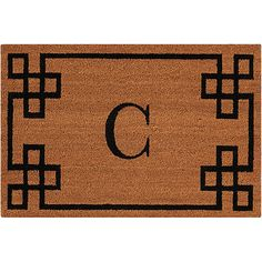 The Nourison Elegant Entry Natural Doormat is made from 100% coir pile. Features an ornate geometric border and a monogrammed 'C'.