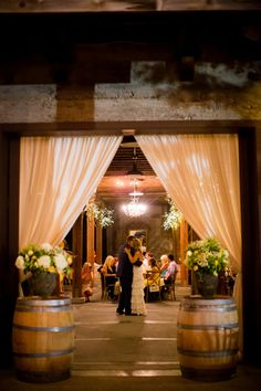 Ways to Use Wine Barrels in Your Wedding Decor ★ wine barrels the bride and groom dance in a barn decorated with wine barrels britt rene photo Wedding Reception Entrance, Reception Decorations, Wedding Centerpieces, Wedding Venues, Barn Weddings, Wedding Favors, Wedding Souvenir, Room Decorations, Indian Weddings