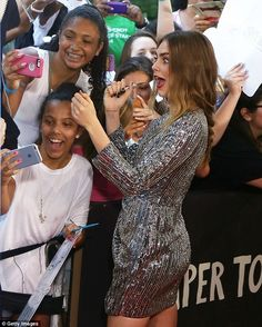 Friendly to fans: Cara was happy to sign autographs and take selfies with her young follow...