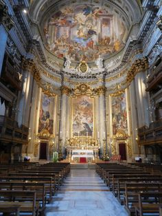 Sant'Ignazio di Loyola, Rome.  The sanctuary is embellished by four ribbed Corinthian semi-columns in the apse.  The altarpiece consist of three paintings  from the life of St. Ignatius.  Above the altarpiece is a gilded stucco relief featuring a scallop shell, and two allegorical figures.