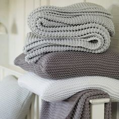 Gorgeous dusted, chalky tones of duck egg blue, plum and white knitted throws by The White Company Textiles, Paper Mulberry, Hygge, Cute Blankets, Throw Blankets, Knitted Throws, Knitted Cushions, The White Company, Layette