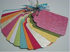 Follow these simple steps to create your own Cuttlebug Swatch Book: 1. Die cut a tag shape out of scraps of cardstock. 2. Emboss each individual tag with the embossing folders that you own. 3. Place all of your embossed tags on a binder ring. 4. Tie a few colorful ribbons on the ring just for fun!