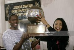 """Florence Griffith Joyner with her husband AL Joyner holding the """"Jesse Owens International Awards Trophy"""" presented to her by the International Amateur Athletic Association Inc. Of New York City,. Flo Jo, Jesse Owens, Black Goddess, Sport Icon, Her World, World Records, Women In History, Track And Field, Florence"""