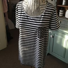 Black & white long top Cute black & white top, longer in back .. Striped part cotton.. Patterned back an pocket sheer material.. Great with stretchies!!  Cute an comfy!! Ernie & joe Tops Tees - Short Sleeve