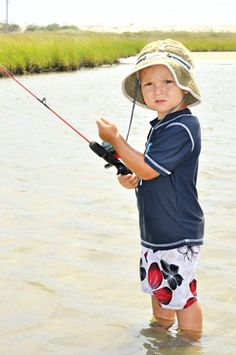 just like Daddy showed him (holding the fishing line to feel a bite)!