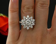 1960's Era 1.06ct Diamond Cluster Engagement Ring in Platinum, PGS Certified, 2.72 carat total weight, Floral Style Engagement Ring