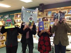 Wolf munches book! Authors at indie store Quail Ridge Books witness mayhem as the Wolf 3000 pencil sharpener from Little Red Writing tries to munch Nine Pound Hammer. Witnessed by authors Joan Holub, John Claude Bemis, Kelly Starling Lyons, and Nathan Kotecki.  http://www.amazon.com/Little-Red-Writing-Joan-Holub/dp/0811878694/ref=sr_1_1?s=books&ie=UTF8&qid=1374000241&sr=1-1&keywords=little+red+writi...