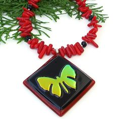 If you love the ethereal beauty of butterflies, you will definitely love the stylish FLYING FREE butterfly pendant necklace. The focal of this handmade necklace is an artisan dichroic glass pendant with a glowing golden yellow butterfly against a background of black and red.
