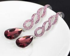 Flowing wine-pink crystal rhinestones trickle down the swirling frame which gives way to lovely large wine-colored gem teardrops. They are simply lovely and the color is to die for. Sold as one pair of post earrings. Crystal Rhinestone, Statement Earrings, Jewelry Accessories, Gems, Bling, Crystals, Vip, Wicked, Wedding Ideas
