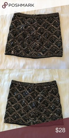 """Embellished Mini Skirt Black mini skirt with sequin embellishments all over the front and back. Zips up the back. 14"""" length. 100% polyester. Excellent condition Forever 21 Skirts Mini"""