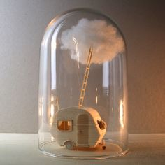 Dutch multidisciplinary artist Vera van Wolferen (previously) produces miniature balsa wood sculptures, architectural objects that are either incorporated into animations or left motionless to tell their own stories. Her static works are often displayed beneath glass bell jars, leaving the audience