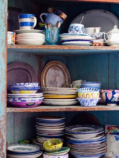 Loving the idea of fun, mismatched dishes.. Gives the kitchen and dining room an artsy flare