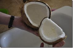 Removing coconut meat from the shell