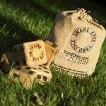 Snake Eyes Yard Dice™ is a great backyard, game room or anywhere game! They are built of solid wood and  branded with their logo and have a rich stained finish. These dice are made to last for years to come.  You'll receive 6 dice and they'll be shipped in an eco-friendly, all natural draw string jute bag that allows for easy transport. We also love that they are made in the USA (in Minneapolis, MN). Included in the bag are instructions for 10 games