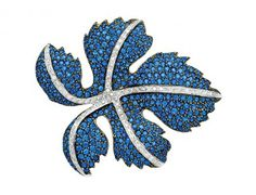 The stylised maple leaf pavé-set with sapphires and accented by lines of round diamonds, mounted in 18k white gold