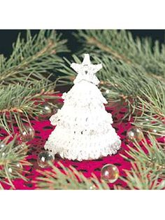 Tiny Christmas Tree - Trim this sweet diminutive tree with white and silver metallic thread.  Designed by Shirley Souch  free pdf from freepatterns.com