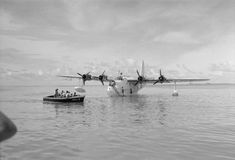 ROYAL AIR FORCE OPERATIONS FAR EAST 1941-1945 (CF 620)   A tender conveys aircrew to Short Sunderland Mark III, EJ143 'S', of No. 230 Squadron RAF Detachment, moored in the lagoon at Addu Atoll, Maldive Islands.