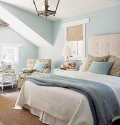 jute rug, tufted headboard, white blankets, blue blanket, soft blue/green walls, bamboo curtain