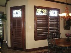 The shutter inserts look like they are made of wrought iron but they are actually custom made from a composite wood material - faux iron. Sliding Window Treatments, Custom Window Treatments, Window Coverings, Metal Shutters, Budget Blinds, World Decor, Tuscan Decorating, Blinds For Windows, Wrought Iron