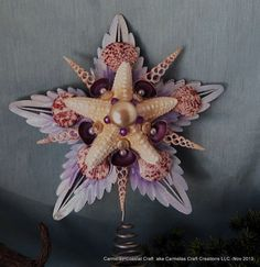 http://www.etsyonsale.com/shop/CarmelasCoastalCraft Coastal Christmas Tree Topper with star by CarmelasCoastalCraft, $28.00