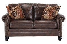 The Gaylon Loveseat from Ashley Furniture HomeStore (AFHS.com). Upholstery features top-grain leather in the seating areas with skillfully matched DuraBlend® upholstery everywhere else.